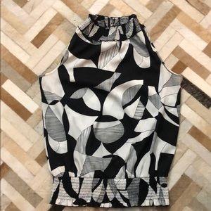 Sleeveless black and white blouse. Size M